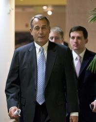 Speaker of the House John Boehner walks to a closed-door meeting with GOP members of the House on Tuesday.
