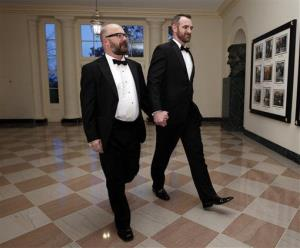 Andrew Sullivan, left, and Aaron Tone arrive at the White House for a State Dinner in this file photo from March 14, 2012.