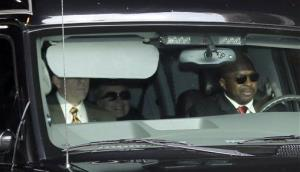 Secretary of State Hillary Clinton, center, is transported on the New York Presbyterian Hospital complex Wednesday.