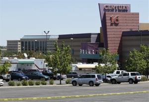 In this July 21, 2012 file photo, police and other vehicles remain in front of the Century 16 movie theater in Aurora, Colo.