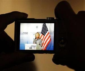 U.Ss Secretary of State Hillary Rodham Clinton is seen on a small camera screen as she  addresses the media during a news conference at the Security Conference, Feb. 4, 2012 in Munich, Germany.