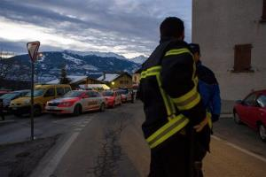 Police patrol in the village of Daillon after a shooting, in Switzerland, early Thursday, Jan. 3, 2013.
