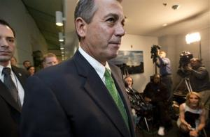 Speaker of the House John Boehner passes reporters as he leaves a closed-door GOP meeting on the fiscal cliff Tuesday.