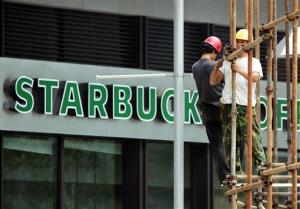 Workers erect scaffolding near a new Starbucks outlet in Beijing in 2007.