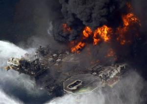 In this April 21, 2010, aerial photo, the Deepwater Horizon oil rig burns in the Gulf of Mexico.