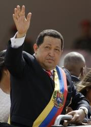 In this July 5, 2012 file photo, Venezuela's president Hugo Chavez waves during a parade marking Independence Day in Caracas, Venezuela.