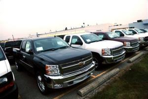 Chevrolet Silverado pickup trucks are seen on a dealer's lot in Troy, Mich., Monday, Dec. 17, 2012.  The Silverado is one of 55,000 new vehicles the company is recalling because of a shifter problem