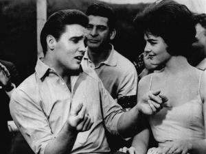 In this undated file photo, Elvis Presley, left, appears in a scene from the movie, Kid Galahad.