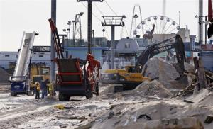 Crews work work to replace the destroyed boardwalk in Seaside Heights, NJ, on Jan. 3.