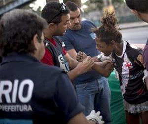 In this photo taken Nov. 22, 2012, an alleged crack addict tries to bite a social worker as she is taken to a nearby shelter in Rio de Janeiro, Brazil.