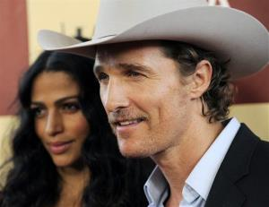 Matthew McConaughey, a cast member in Bernie, poses alongside his wife Camila Alves at the premiere of the film on the opening night of the 2011 Los Angeles Film Festival, June 16, 2011.