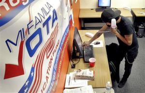 Pedro Yazzie makes phone calls on Nov. 6, 2012, in Phoenix to registered voters from the offices of Mi Familia Vota, a non-partisan effort to increase voter participation among Latinos and others.