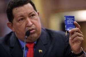 In this Oct 9, 2012, file photo, Venezuela's President Hugo Chavez holds a miniature copy of his country's constitution during a news conference in Caracas, Venezuela.