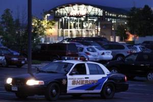 File photo: A Douglas County Sheriff's vehicle is parked in front of the AMC 24 movie theater in July in Highlands Ranch, Colo., part of beefed-up security after the Aurora massacre.