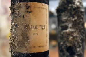 One of four bottles of 1875 Armagnac Vieux, covered in a black fungus and unearthed from the labyrinthine wine cellar this week, are seen at La d'Argent restaurant in Paris, Thursday Oct. 15, 2009.