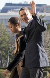 President Obama waves to the media as he walks with daughter Malia on the first family's return from vacationing in Hawaii, on the South Lawn of the White House, Sunday, Jan. 6, 2013.