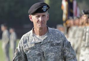 This July 23, 2010, file photo shows Gen. Stanley McChrystal reviewing troops for the last time as he is honored at a retirement ceremony at Fort McNair in Washington.