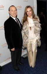 Music producer Tommy Mottola and wife singer Thalia arrive at A Funny Thing Happened On The Way To Cure Parkinson's the Michael J Fox Foundation benefit gala on Wednesday, Nov. 5, 2008 in New York.