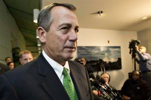 In this Jan. 1, 2013, file photo, Speaker of the House John Boehner walks past reporters after a closed-door meeting meeting of House Republicans at the Capitol in Washington.