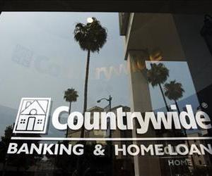 In this June 25, 2008 file photo, buildings and palm trees are reflected on the entrance of the Countrywide Financial Corp. office in Beverly Hills, Calif.