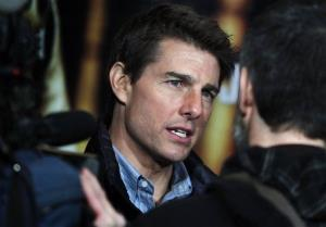 Tom Cruise speaks to the press during a 'Jack Reacher' film presentation at the Callao Movie Theater, in Madrid, Spain, Thursday, Dec. 13, 2012.