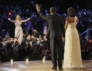 President Barack Obama, left, and first lady Michelle Obama wave to singer Beyonce after their first dance together at the Neighborhood Inaugural Ball in Washington, Tuesday, Jan. 20, 2009.