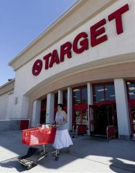 In this Tuesday, July 16, 2011 photo, a customer leaves a Target store in Los Angeles.