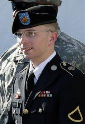 In this June 25, 2012 file photo, Army Pfc. Bradley Manning is escorted out of a courthouse in Fort Meade, Md., after a pretrial hearing.