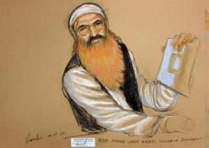 In this photo of a sketch by courtroom artist Janet Hamlin, Khalid Sheikh Mohammed holds up a piece of paper during a court recess at his Military Commissions pretrial hearing.