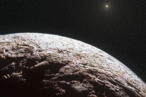 This artist impression, provided by the European Southern Observatory and the journal Nature, shows the surface of the distant dwarf planet Makemake.