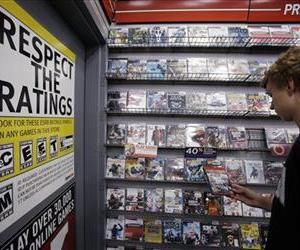 Jack Schooner, 16, looks at Grand Theft Auto video game at GameStop in Palo Alto, Calif., Monday, June 27, 2011.
