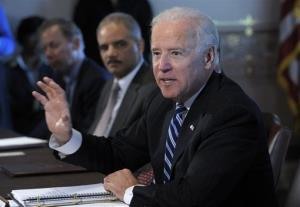 Vice President Joe Biden, accompanied by Attorney General Eric Holder, gestures as he speaks during a meeting Thursday.