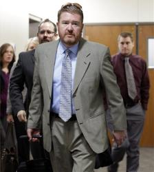 Defense attorney Daniel King leads his team to court for the third day of a preliminary hearing for Aurora theater shooting suspect James Holmes.