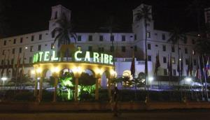 In this April 19, 2012, file photo, people walk past Hotel El Caribe in Cartagena, Colombia.