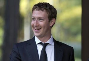 FILE-In this Monday, Oct. 1, 2012, file photo, Facebook CEO Mark Zuckerberg, smiles for photographers at the Gorki residencewhile meeting with the Russian Prime Minister Dmitry Medvedev in Moscow. Facebook's third-quarter results released Tuesday, Oct. 23, 2012, inched past Wall Street's expectations, offering evidence that the company is making inroads...