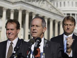 Rep. Joe Wilson, R-S.C., center, accompanied by Rep. Phil Gingrey, R-Ga., and Rep. Dean Heller, R-Nev., gestures during a news conference on Capitol Hill in Washington, Wednesday, Nov. 4, 2009.