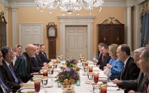 Secretary of State Hillary Rodham Clinton, on right side of table, dines with Afghanistan President Hamid Karzai, left, in a small room at the State Department in Washington, Thursday, Jan. 10, 2013.