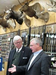 NRA President David Keene, left and Republican gubernatorial candidate Rick Hill discuss gun rights Wednesday, Oct. 3, 2012 in a Great Falls, Mont., sporting goods store.