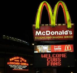 A McDonald's restaurant sign advertises to Chicago Cubs fans across the street from Wrigley Field in Chicago, Monday, April 20, 2009.
