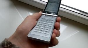 The Fujitsu F-04D cell phone in titanium silver.