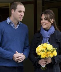 Britain's Prince William stands next to his wife Kate, Duchess of Cambridge as she leaves the King Edward VII hospital in central London, Thursday, Dec. 6, 2012.