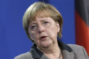 German Chancellor Angela Merkel addresses the media during a joint press conference after a meeting with the Prime Minister of Malta, Lawrence Gonzi, unseen, at the chancellery in Berlin, Germany, Wednesday, Jan. 9, 2013.