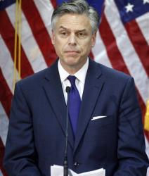 In this  Monday, Jan. 16, 2012, file photo, Jon Huntsman pauses while announcing he is ending his campaign in Myrtle Beach, SC.