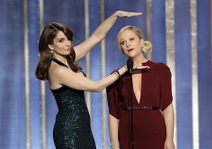 This image released by NBC shows co-hosts Tina Fey, left, and Amy Poehler on stage during the 70th Annual Golden Globe Awards held at the Beverly Hilton Hotel on Sunday, Jan. 13, 2013, in Beverly Hills, Calif.