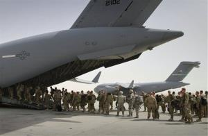 US soldiers board a military plane as they leave Afghanistan.