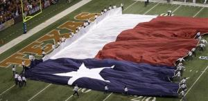 The Texas flag is run on to the field prior to the Alamo Bowl NCAA football game between Oregon State and Texas.