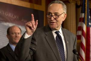 Sen. Charles Schumer, D-N.Y., right, accompanied by Sen. Chris Coons, D-Del., gestures during a news conference on Capitol Hill in Washington, Thursday, Dec. 6, 2012.