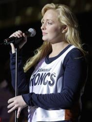 Country singer Mindy McCready performs at a Nashville Broncs basketball game Nov. 14, 2008, in Nashville, Tenn.