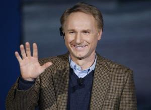 Dan Brown, author of The Da Vinci Code, waves as he appears on Italian state TV in 2009.