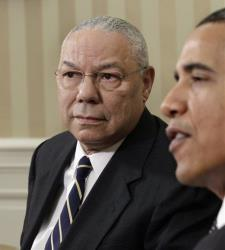 President Obama talks with reporters after a meeting with former Secretary of State Colin Powell, left, in 2010.